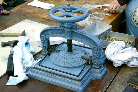 Blue hand, bookbinding press