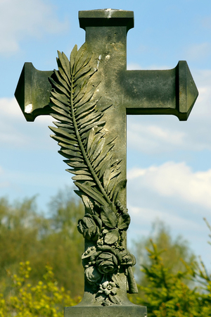 Carved tombstone with a sandstone pen