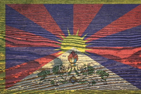 The flag of Tibet is painted on a wooden board with a wooden structure Stock Photo