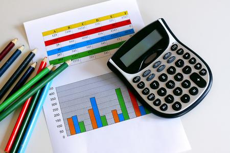Calculator with calculator, crayons and graph Reklamní fotografie