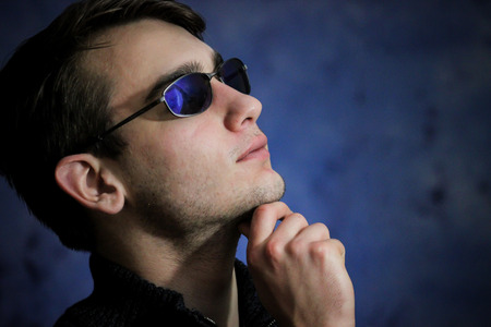 color photographs: Side View of Confident Teen Wearing Sunglasses