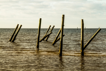 What s left of a pier destroyed by hurricane Katrina in Waveland, MS Stock Photo - 17357043