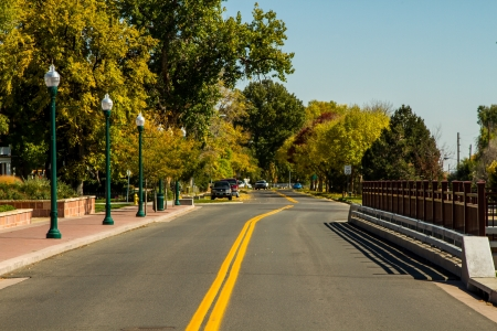 boulders: Tree lined street in Boulder, Colorado with no traffic, and green rustic street lights
