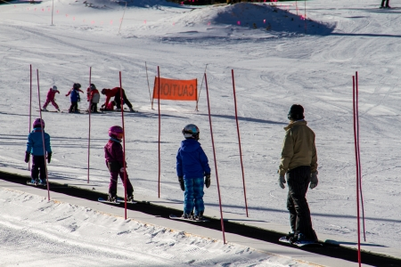 Kids ride up the bunny hill for ski lessons photo