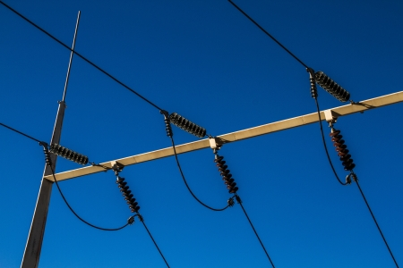 alumina: Overhead high-power lines and ceramic insulators connecting to a substation