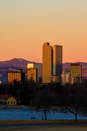 denver skyline at sunrise: Denver, Colorado city skyline in winter verticle Stock Photo
