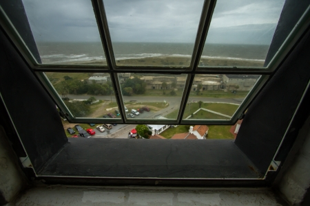 lighthouse keeper: Looking out the a open window of the Tybee Island Lighthouse on a stormy afternoon