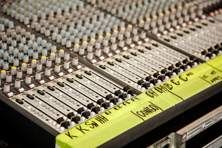 public address: Concert audio mixing desk or sound board for live performance