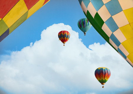 faa: Five hot air balloons sailing with blue sky and clouds Stock Photo