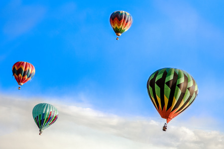 faa: Four hot air balloons sailing high above the clouds