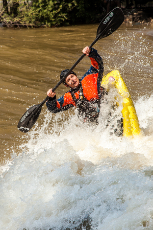 kayaker: Salida, USA - June 20, 2015: Professional freestyle kayaker at the 2015 FIBArk Freestyle Whitewater Rodeo competiton at Riverside Park, Arkansas River, Salida, Colorado. This kayaker is competing for points in the Freestyle Pro Semi-Finals event.