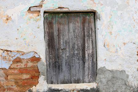 peeling paint on a wooden door Stock Photo