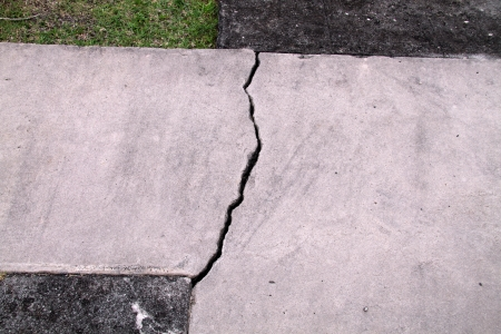 foundation cracks: cracked cement walkway Stock Photo