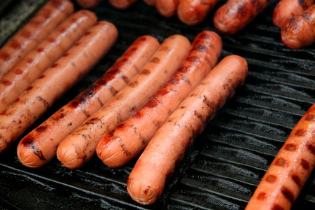 grill: hot dogs on a barbecue grill Stock Photo
