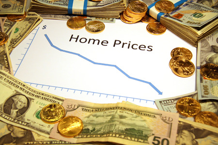 home prices: graph chart with home prices falling down with gold money Stock Photo