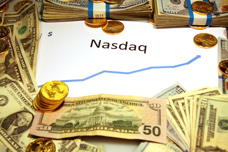 nasdaq: graph chart with nasdaq rising up with gold money