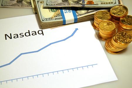 nasdaq: nasdaq rising up chart graph with gold money