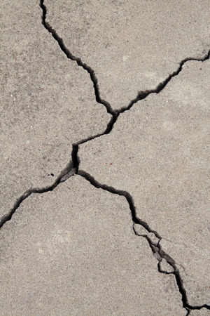settling: cracked concrete cement sidewalk foundation Stock Photo