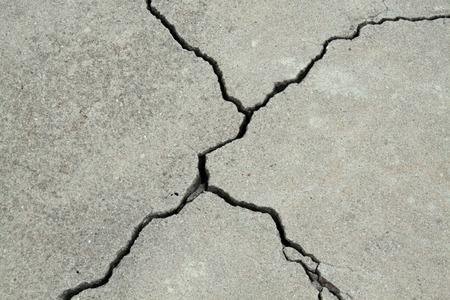 cracked concrete cement sidewalk foundation Foto de archivo
