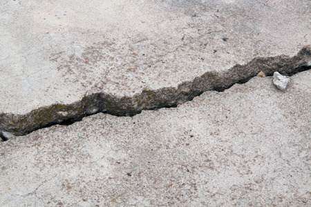 cracked concrete: cracked concrete cement sidewalk foundation Stock Photo