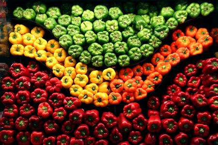 red green yellow orange peppers on display Reklamní fotografie