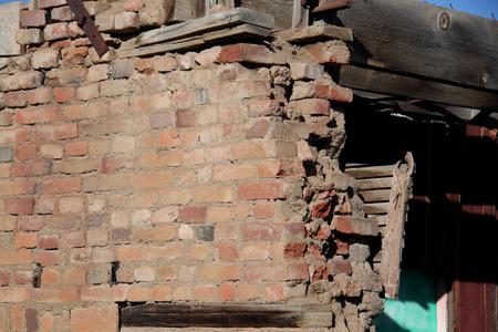 falling apart: brick wall collapsing and falling apart