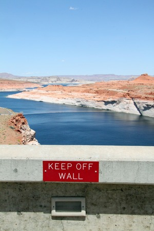keep off wall sign on a dam