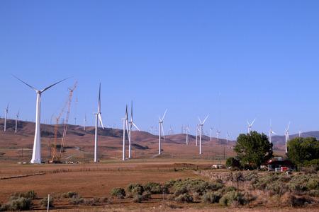 Electrical energy Windmill being built near a farm house