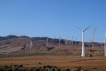 electrical energy Windmill being built near a farm house Reklamní fotografie