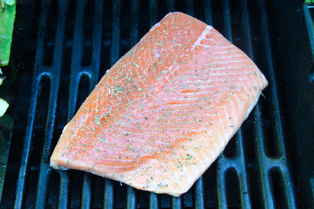 grilled salmon steak fillet on fire closeup cook Stock Photo