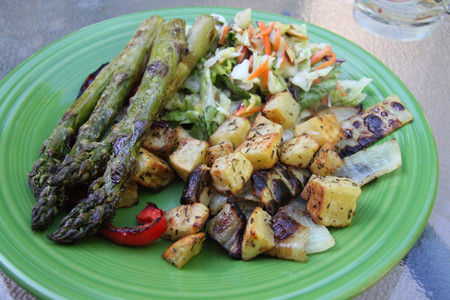 closeup grilled vegetables asparagus potatoes plate