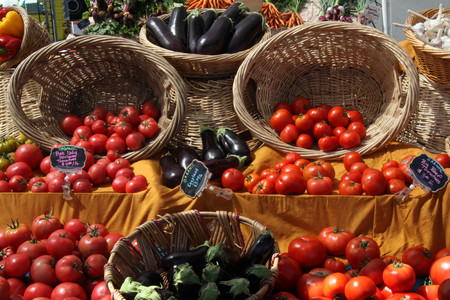 tomatoes in baskets at farmers market