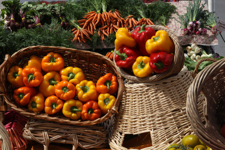 yellow and red peppers in basket at farmers market