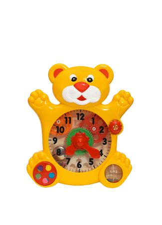 there is the toy clock. the clock is very interesting and useful for children. they can play and learn the time and numbers.  it has a form of puma or leon. the clock face is transparent. you can see inside gear wheels and bell. Stock Photo