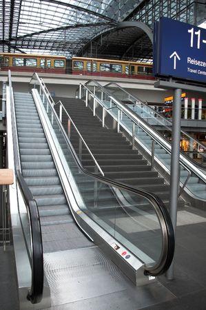 a tran is in the railwaystation, the main railwaystation in Berlin.