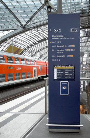 pictogramm: a train is in the railwaystation, the main railwaystation in Berlin