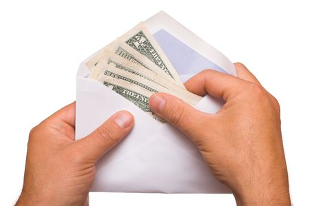 human hands is counting a cash in an envelope on white