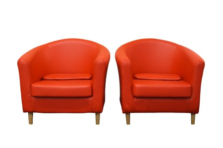 two red armchairs are on white