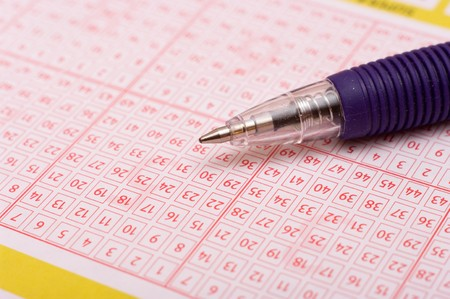 a pen is on a lottery ticket Stock Photo