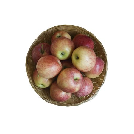 a basket with apples is on white background