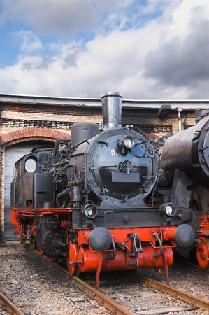 an old steam lokomotive is in the depot Stock Photo