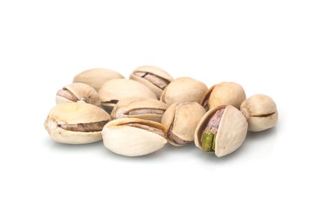 pistachio nuts are on white