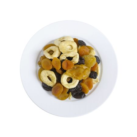 plate with dried fruits is on white background