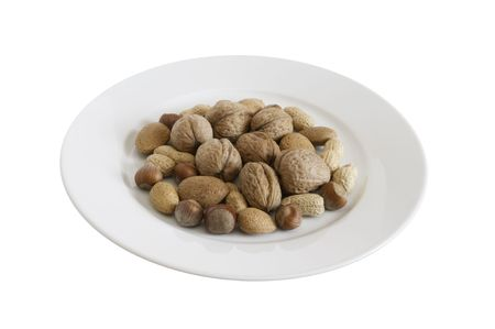 nuts are on the plate on white background Stock Photo