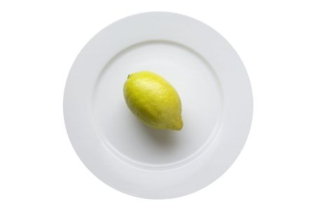 lemon is on the plate on white background