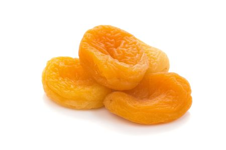 dried apricots are on white background