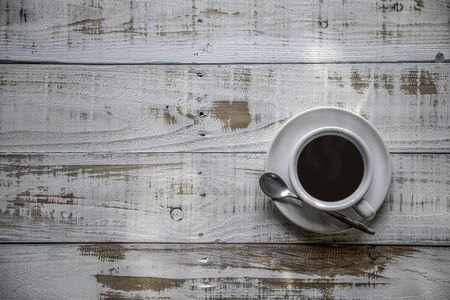 White coffee cup top view on wooden  background with copy space Foto de archivo