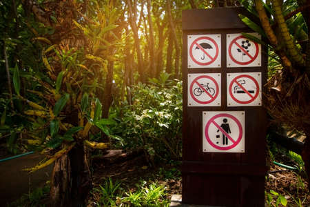 26 july 2020, Royal park ,ChaingMai, Thailand. Warning sign on display of Do not open umbrella,  Do not pick flowers, Do not ride a bicycle, No smoking and Do not litter in Royal park , ChaingMai, Thailand.
