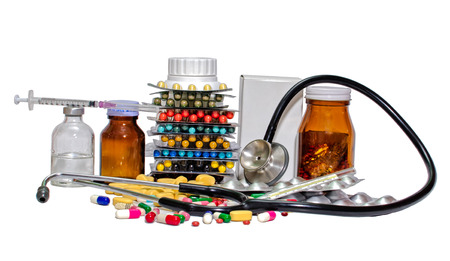 syring: Various colour pills capsule,Syring, stethoscope on a white background  Stock Photo