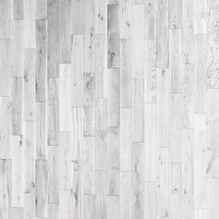 白い木製寄木細工の床の水平のシームレスな木製の背景のテクスチャ